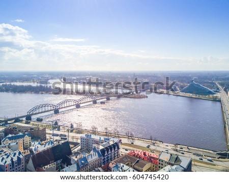Aerial View of Latvia's Capital Riga  River  Bridge  Sunny Day