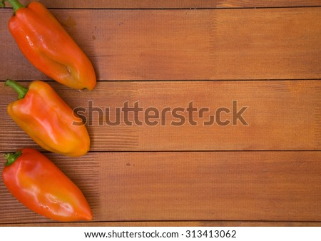 Fresh red peppers on a wooden base