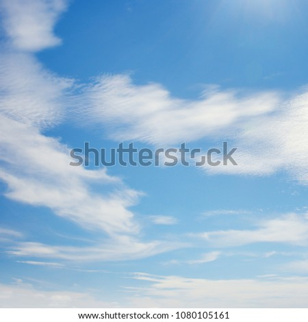 White clouds illuminated by bright sun. Copy space