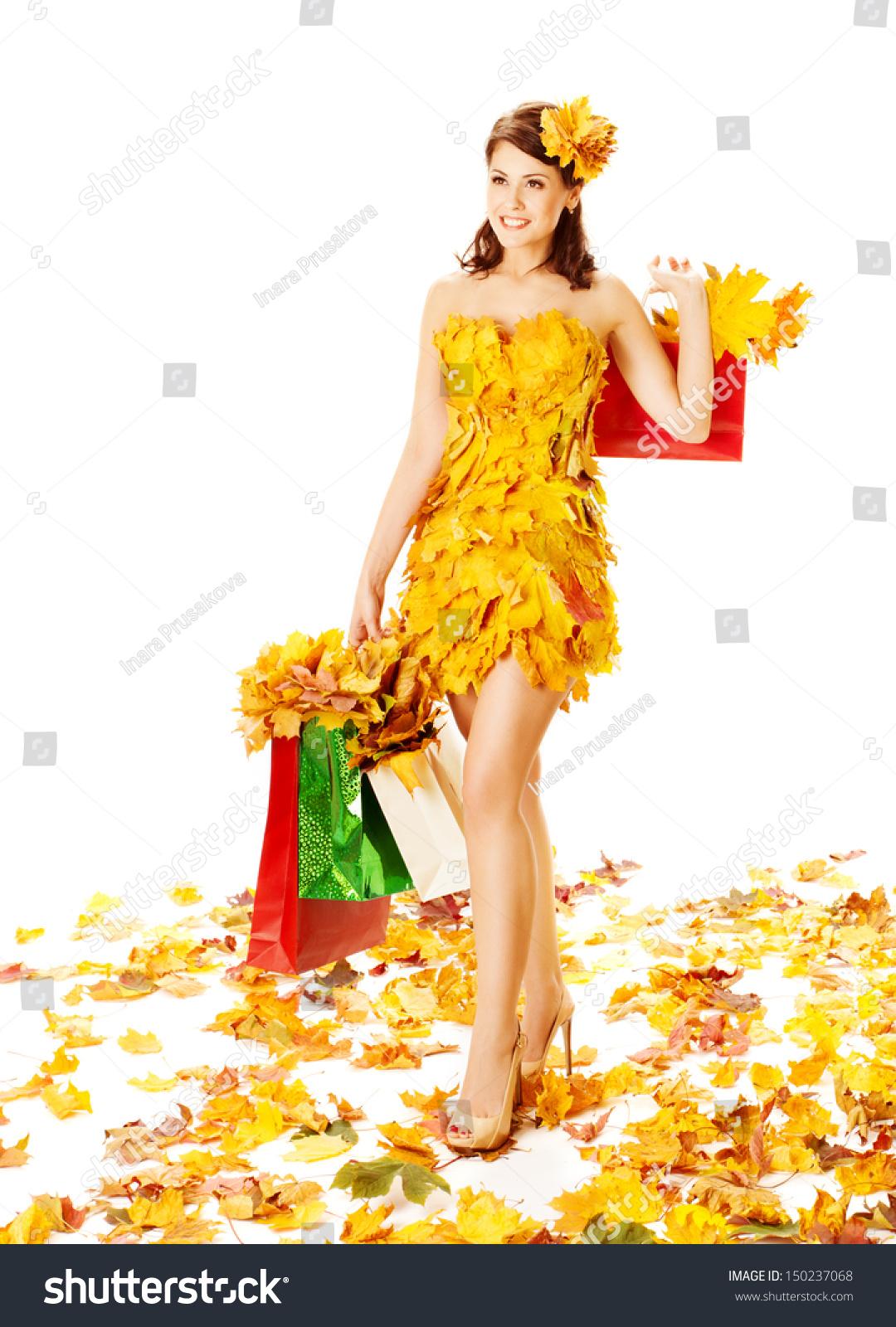 秋天的女人购物袋枫叶的衣服.白色背景