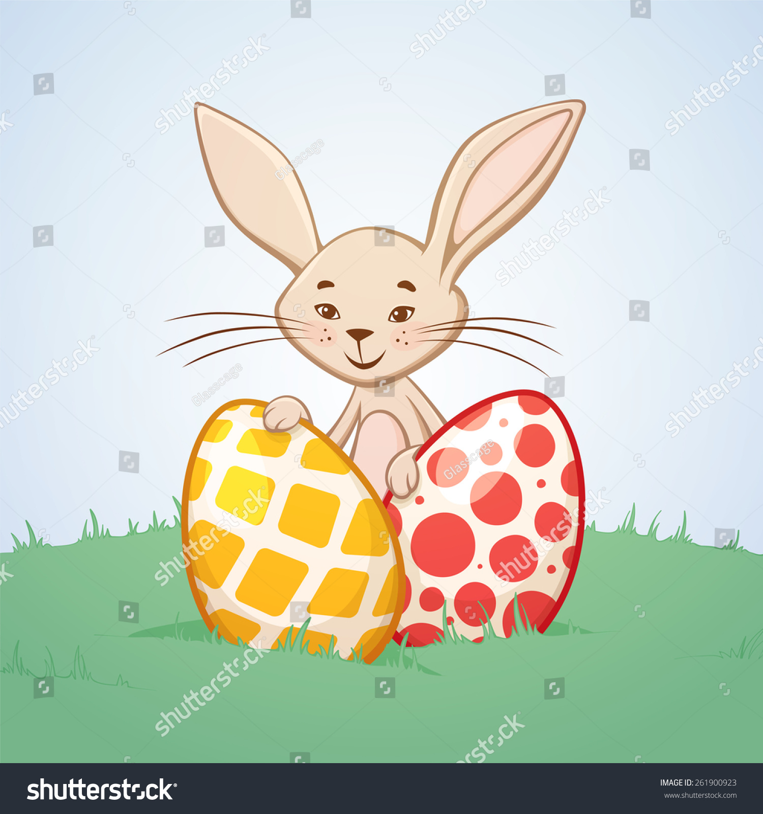 可爱的复活节兔子,有两只彩色的鸡蛋在一个草地上